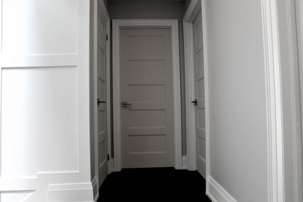 custom home hallway with wainscot wall decor and baseboard trim