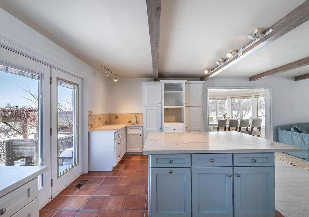 luxury kitchen with blue kitchen cabinet island - painters toronto