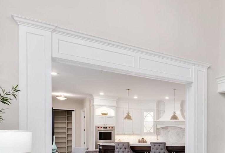 custom hallway with crown moulding trim over door way