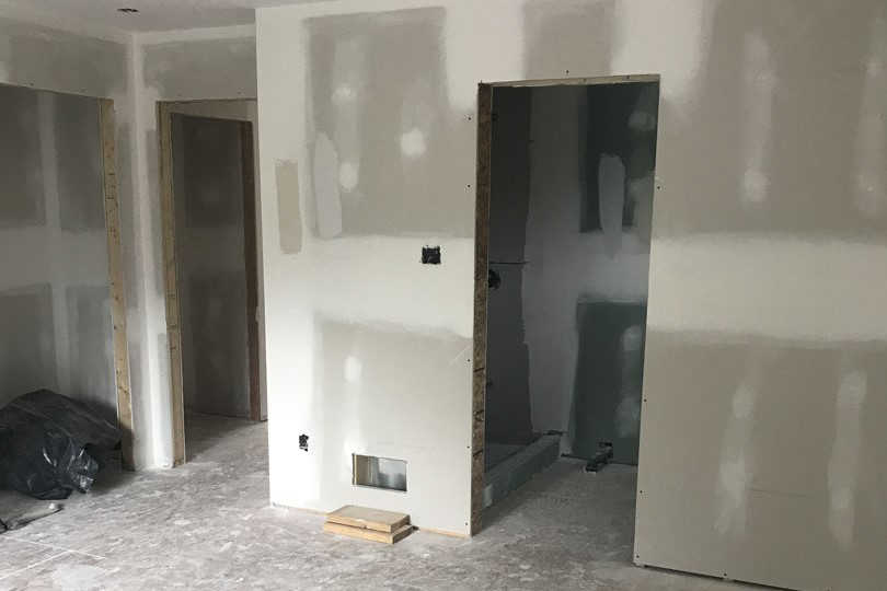drywall installation in new basement finishing