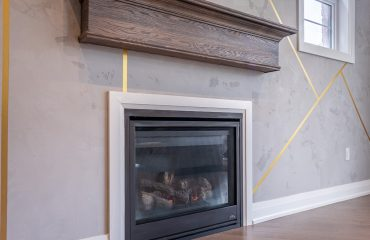 build in fireplace and shelve in custom family room