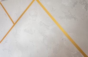 gold shapes on gray wallpaper by prestige painting